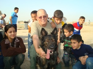 Al+and+Tess+pose+with+happy+Iraqi+children