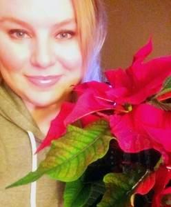 Allison and a poinsettia plant