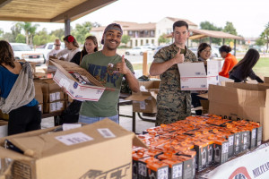 Photo of volunteers packing boxes.