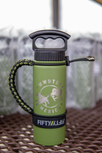 A close-up photo of the FIFTY/FIFTY brand water bottle included in every care package.