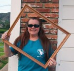 Jan Slotar holding up a picture frame so you can picture yourself as a volunteer!