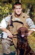 Lance Cpl. William H. Crouse IV and his detection dog Cane.