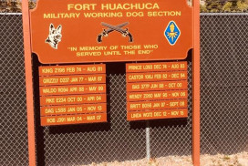 This photo shows a Fort Huachuca kennel sign that lists military working dogs who have crossed the rainbow bridge.