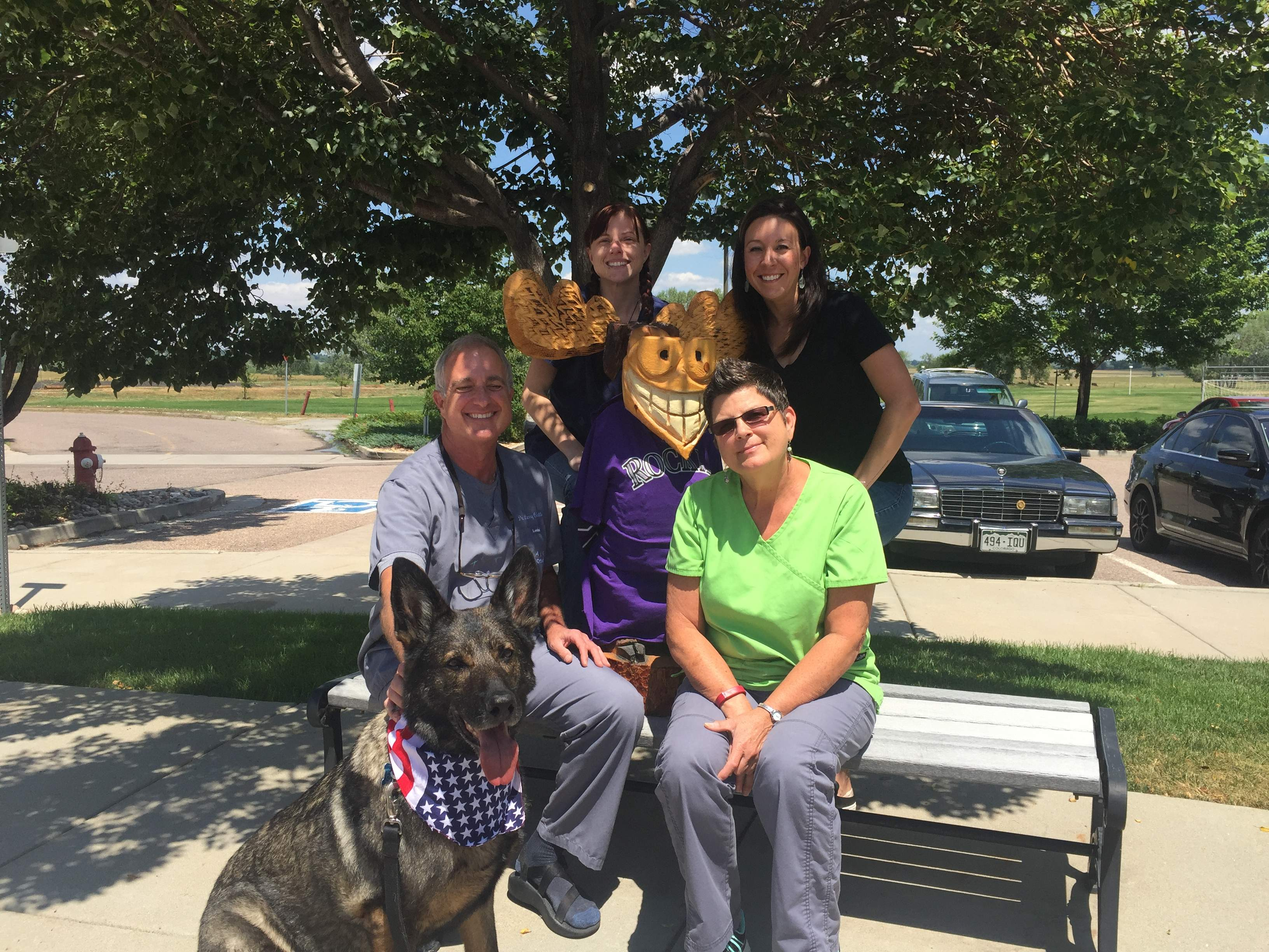 This photo shows the Align Orthodontics staff, including Dr. Colletti, along with wooden moose mascot Justin Timbertooth and guest RMWD Falco.