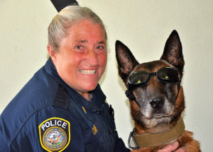 This photo shows Retired Chief Petty Officer Millie Canipe with MWD Rex.