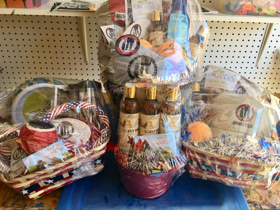 This photo shows gift baskets of MWDTSA and Luck Dog Shampoo merchandise for the raffle.
