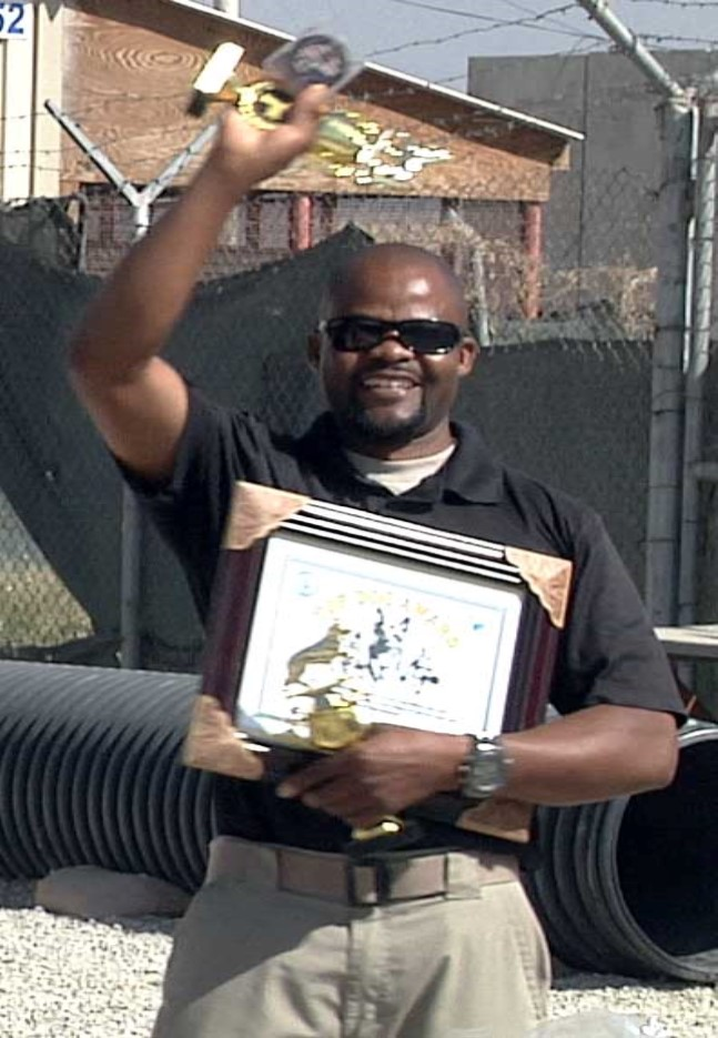 Dog handler Frank Musoli holds prizes from the K9 competition.