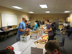 This image shows the packing team working in the style of an assembly line.
