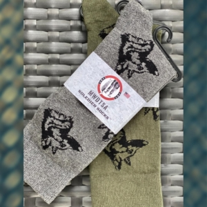 This photo shows two pairs of Soledier Socks with a portrait of MWD Mminto woven in black thread into the knit. One pair is grey and the other is Army Green.