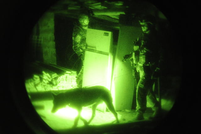 U.S. Air Force Staff Sgt. Francis from Offutt Air Force Base, Neb., and his military working dog, Z, search abandoned lots in Bacharia, Iraq, Dec. 17, 2008, as part of a joint search of the community conducted by 4th Squadron, 5th Cavalry Regiment, 2nd Brigade, 1st Infantry Division. (U.S. Air Force photo by Senior Airman Daniel Owen/Released)